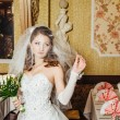Portrait beautiful bride with bouquet of flowers on luxury interior in wedding day — Stock Photo #72198389