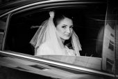 Close-up portrait of pretty shy bride in a car window — Stok fotoğraf