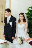 Wedding ceremony. Registry office. A newly-married couple signs the marriage document. — Stock Photo