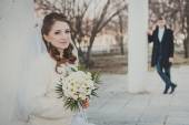 Elegant bride and groom posing together outdoors on a wedding day — Stock Photo