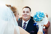 Handsome groom first time meets his bride at her house on a wedding day — Stock Photo