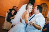 Beautiful caucasian couple just married and dancing their first dance. — Stock Photo