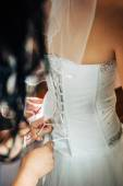 Beautiful bride getting ready in white wedding dress with hairstyle and bright makeup. Happy sexy girl waiting for groom. Romantic lady in bridal dress have final preparation for wedding. — Stock Photo