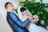 Wedding ceremony. Registry office. A newly-married couple signs the marriage document.Young couple signing wedding documents. — Стоковое фото