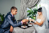 Charming bride and groom on their wedding celebration in a luxurious restaurant. Loving couple on date — Stock Photo
