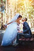 Bride and Groom at wedding Day walking Outdoors on spring nature. Bridal couple, Happy Newlywed woman and man embracing in green park. Loving wedding couple outdoor — Stock Photo