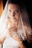 Bride getting ready. beautiful bride in white wedding dress with hairstyle and bright makeup. Happy sexy girl waiting for groom. Romantic lady in bridal dress have final preparation for wedding — Stock Photo