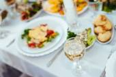 Catering table set service with silverware and glass stemware at restaurant before party. — Stock Photo