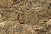 Wall from chipped stone — Stock Photo