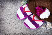 Straw hat and flip flops — Stock Photo