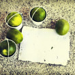 Little white buckets with limes — Stock Photo #60781731