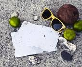 Papers, limes, coconut and sunglasses — Stock Photo