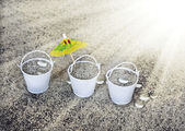 Little white buckets full of sand — Stock Photo