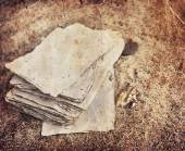 Papers over sand texture — Stock Photo