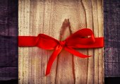 Red Bow on wooden Gift — Stock Photo
