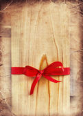 Red Bow on wooden Gift — Fotografia Stock