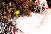 Christmas candies and fir branches — Stock Photo