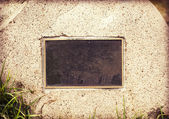 Weathered plaque in wall stone — Stockfoto