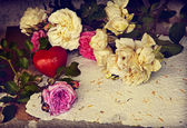 Roses, red heart and handmade paper — Stock Photo