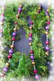Christmas decorations on fir tree — Stock Photo