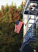 American flag on apartment building — Stock Photo