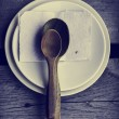 Wooden spoons and  ceramic plates — Stock Photo #66080667