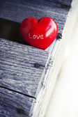 Red heart on wooden table — Stock Photo