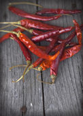 Red hot chili peppers on table — Stock Photo