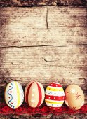Easter eggs on old wooden background — Stock Photo