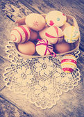 Colorful Easter eggs in a little basket. — Stock Photo