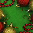 Six christmas balls and red beads — Stock Photo #60748561