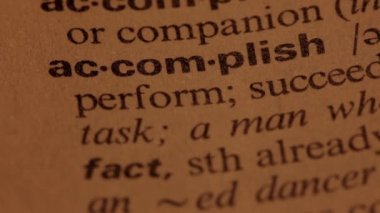 Word Accomplish in a dictionary — Stock Video
