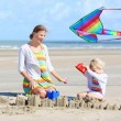Mother and daughter having fun on the beach — Stock Photo #52320513