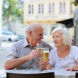 Lovely senior couple relaxing in outdoors street cafe — Stock Photo #52320529