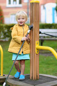 Happy preschooler girl having fun at playground — Stock Photo