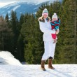 Mother and daughter outdoors in winter — Stock Photo #52978811