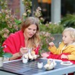 Mother and daughter in outdoors cafe — Stock Photo #52978887