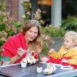Mother and daughter in outdoors cafe — Stock Photo #52978889