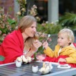 Mother and daughter in outdoors cafe — Stock Photo #52978891