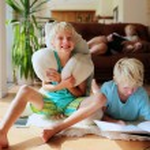 Happy family enjoying time at home — Stock Photo