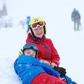 Two boys having fun at ski resort — Stock Photo