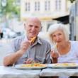 Senior couple relaxing in outdoors cafe — Stock Photo #53545121