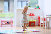 Little girl dancing in the room — Stock Photo