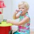 Preschooler girl playing with toy kitchen — Stock Photo #53877595