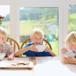 Children eating breakfast in the kitchen — Stock Photo #53877803
