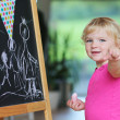 Preschooler girl drawing on black board — Foto Stock