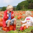 Brother and sister playing at Halloween pumpkin patch — Stock Photo #54522191