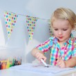 Cute preschooler girl drawing on paper — Stock Photo #54859749