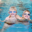 Two brothers having fun in swimming pool — Stock Photo #55742805
