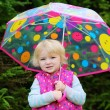 Portrait of little girl with colourful umbrella — Stock Photo #55742961